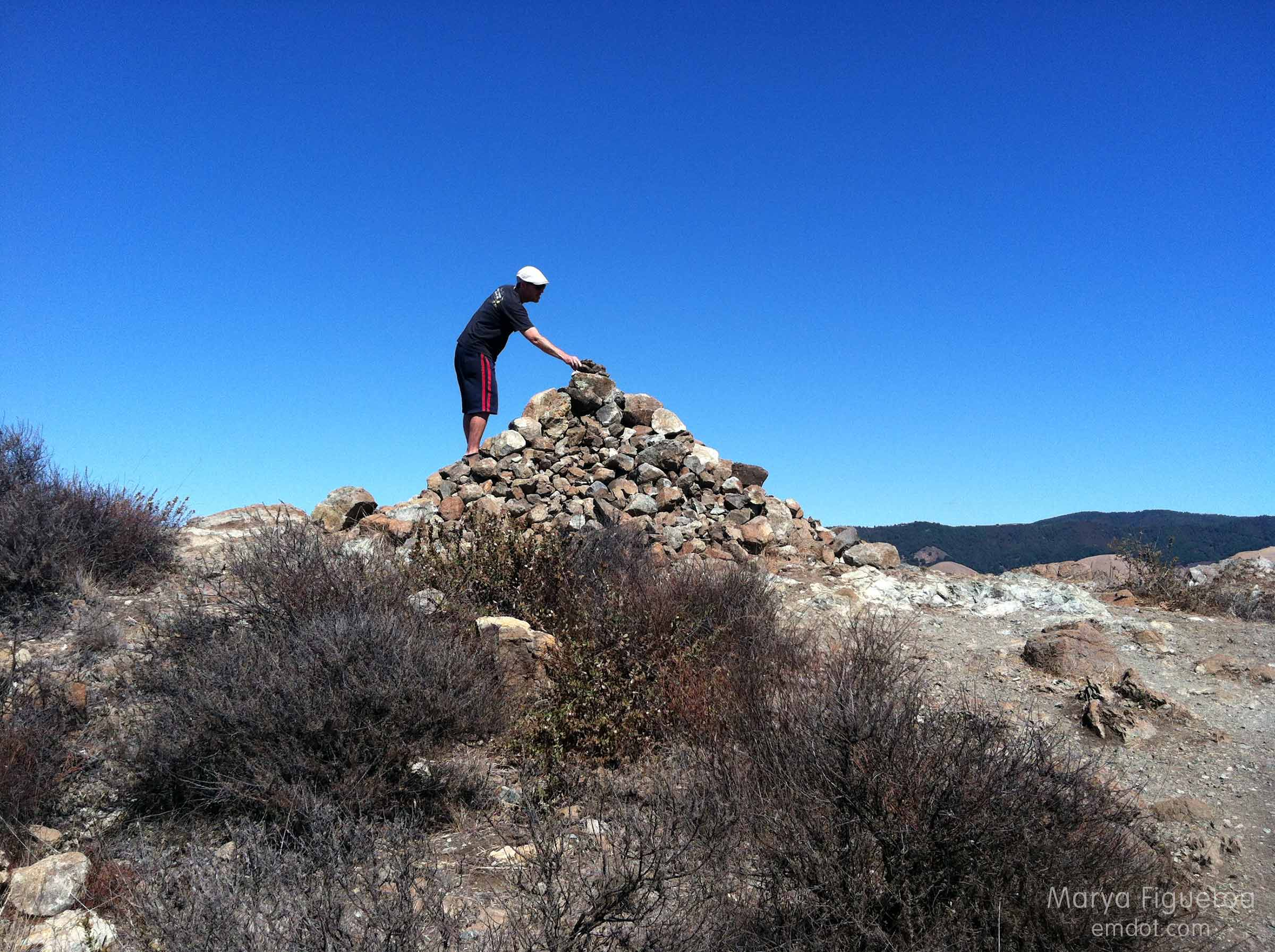 the cairn at the top of the trail