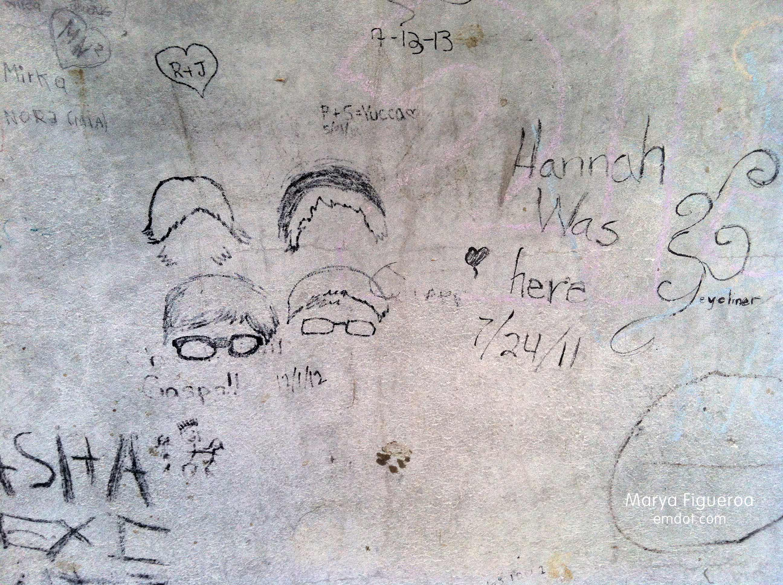 graffiti inside the structure (faces with glasses)